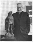 Paul L. O'Connor, S.J., President of Xavier University, with D'Artagnan Bronze Miniature