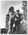 Man Dressed as D'Artagnan while Standing with D'Artagnan Statue