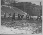 Football team playing at Corcoran Field